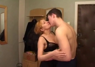 Mom with big mouth sucks her son on the knees