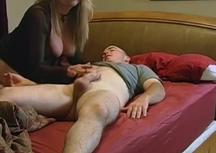 Mom with big boobs jerks off her son dick